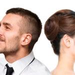 Cirurgia ortognática: Foto de um homem e uma mulher (ambos com problemas ortognáticos) de costas para o outro