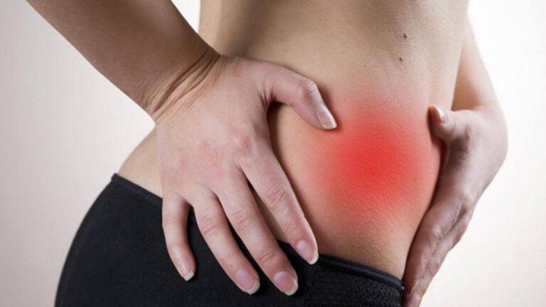 Imagem ilustrativa de pessoa com dor no abdome, representando a apendicite